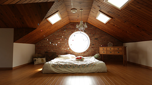 white bed linen inside brown wooden room