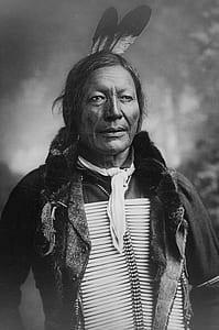 grayscale photo of male Native American