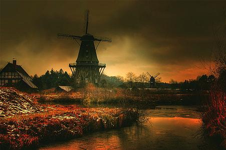 gray windmill taken sunset
