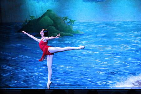 woman wearing red dress dancing