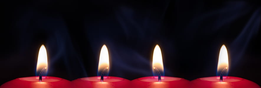four red lit candles