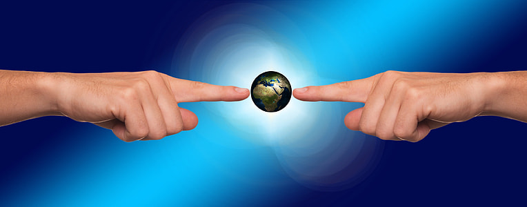 person hand pointing on earth
