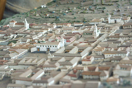 selective focus photography of village miniature