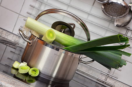 sliced vegetable in grey stainless steel pot