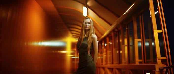 woman in black dress standing on isle