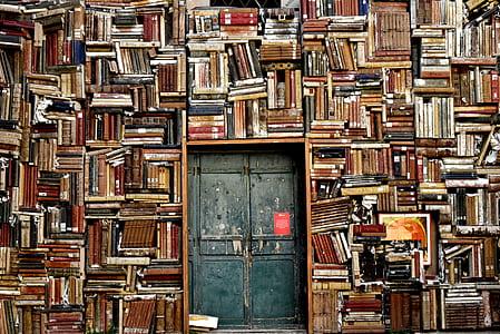 photo of wall book and black door