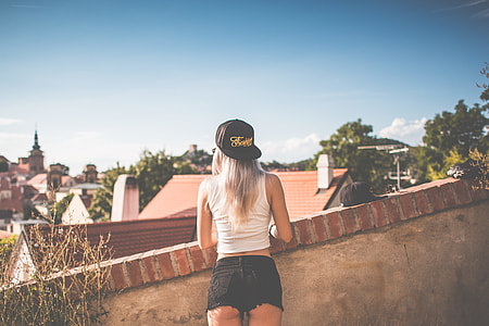 Young Girl with Snapback Looking over the Old City