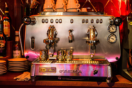 An expresso coffee machine sits in a bar cafe in Central Paris, France. Image captured with a Canon 6D