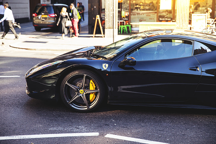 A black Ferrari car on the streets of East London