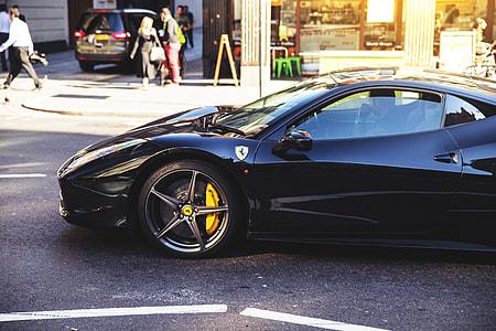 A black Ferrari car on the streets of East London