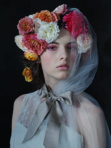 woman wearing floral head dress and white veil