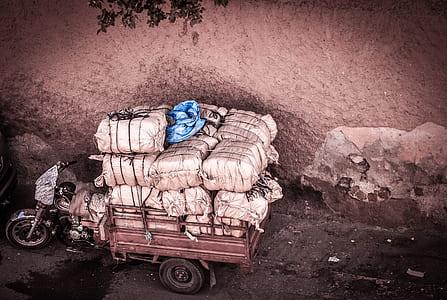 red and black auto rickshaw with white sacks