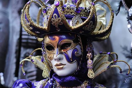 woman wears masquerade mask closeup photo