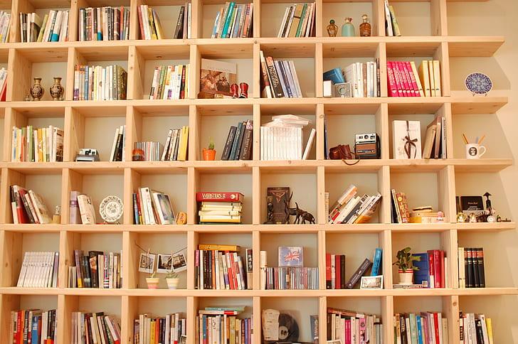 beige wooden bookshelves