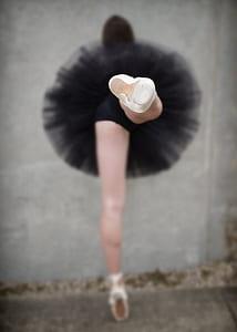 woman wearing black tutu skirt performing ballet dance