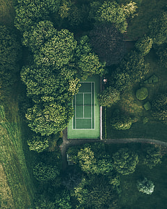 aerial view of tennis court between trees