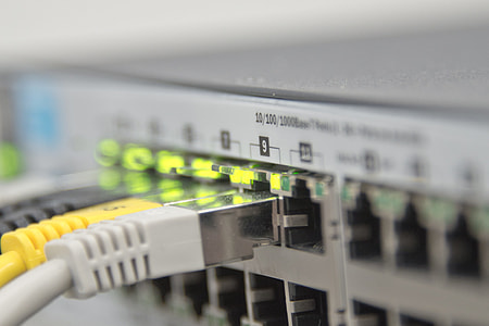 closeup photo of patch panel with cords