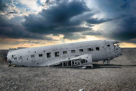 white airplane on land