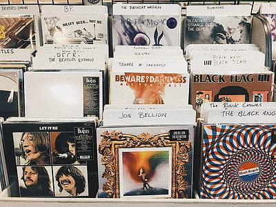 vinyl record sleeved displayed on rack