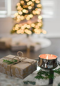 Close-Up Photography of Gift Besides Candle