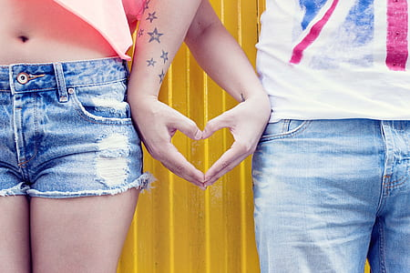 couple forms heart on hand