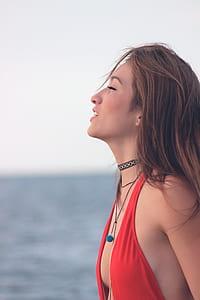 photo of woman wearing red bikini top