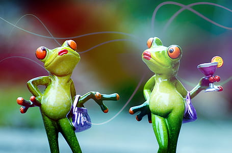 two green frogs holding bag and martini glass