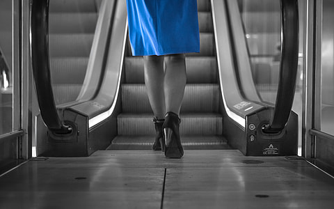 selective color photography of woman in blue dress