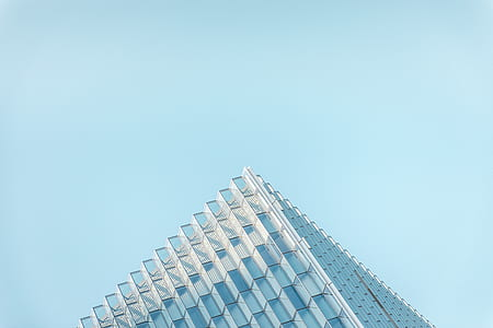 glass window skyscraper building under clear blue sky during daytime