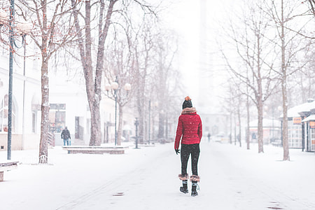 Young Woman Walking Alone in The Park in Snowy Weather
