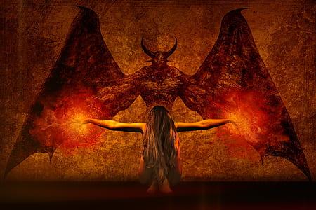 woman kneeling in front of demon artwork