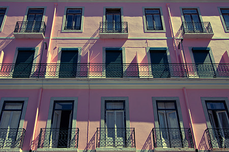 Wide-angle shot of a pink-coloured building in Lisbon, Portugal