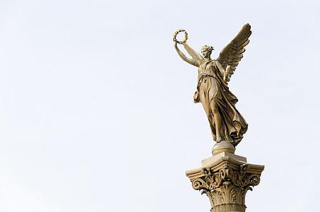 angel wearing dress statue