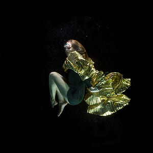underwater photography of woman in green dress