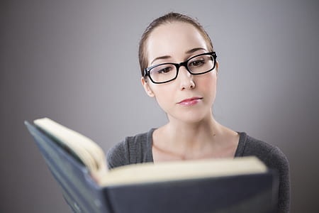 woman in front of black covered book