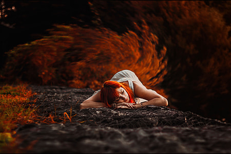 A woman lying down in the Autumn
