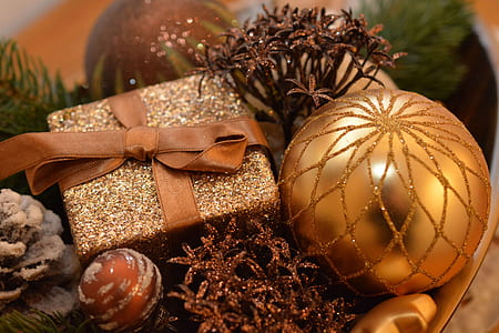 close-up of gold-colored bauble and glittery box