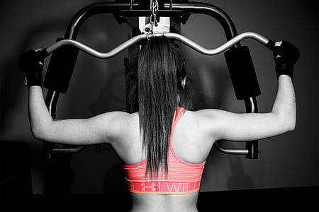selective color photography of woman in pink sport bra