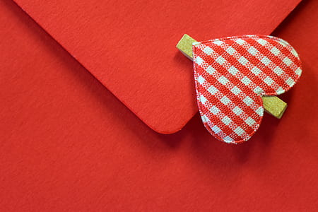 white and red checkered heart pin