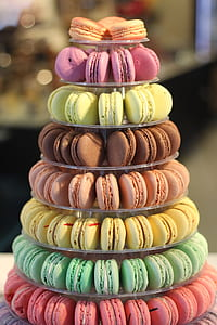 assorted-color of macarons on clear glass 8-tier tray