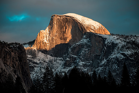 brown rock mountain with snow