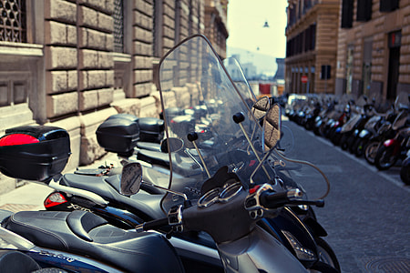 A long row of motorbikes line-up in Napoli, Italy