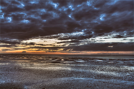 Seascape shot taken of the coast of Southern England on a stormy sunset evening