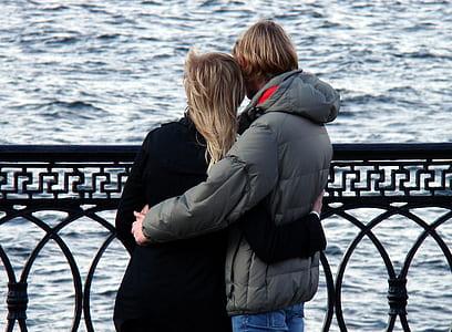 Man in Grey Bubble Jacket Beside Woman in Black Sweater
