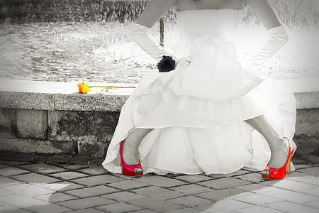 woman wearing white strapless dress