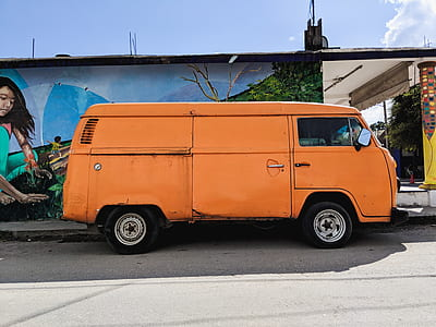 orange van beside concrete house