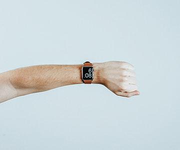person arm wearing Apple Watch