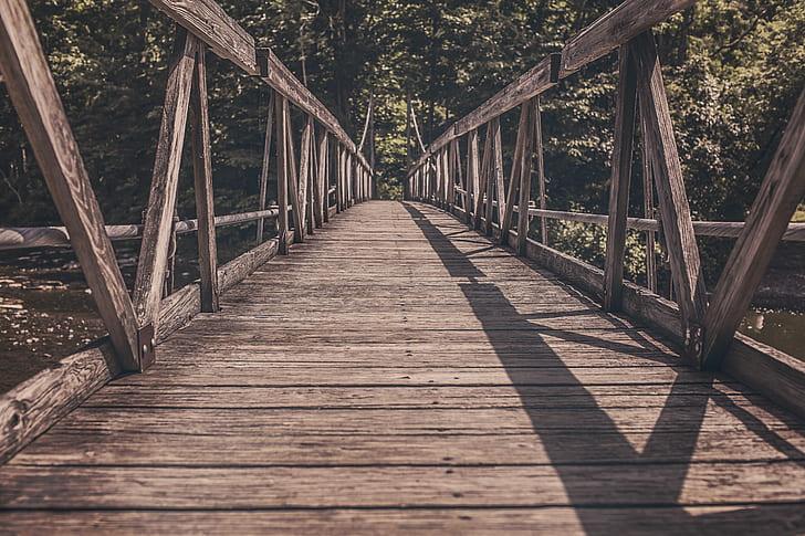 photo of brown wooden bridge