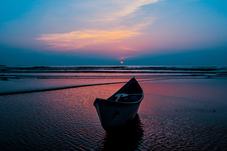 boat on water during sunset