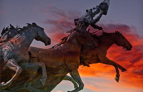 horse statue under cloudy sky